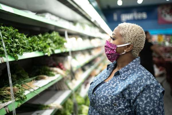 masked woman at grocery store